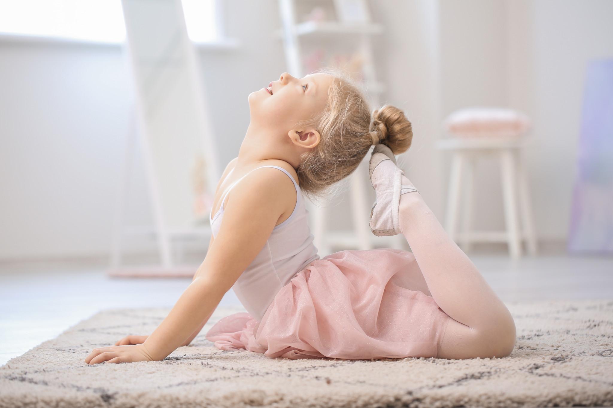 Cute little ballerina at home